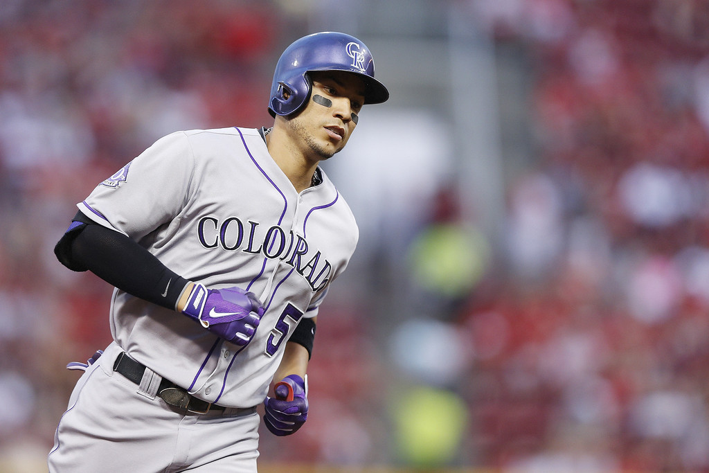 . Carlos Gonzalez #5 of the Colorado Rockies rounds the bases after hitting his second home run of the game in the fourth inning against the Cincinnati Reds at Great American Ball Park on June 5, 2013 in Cincinnati, Ohio. (Photo by Joe Robbins/Getty Images)