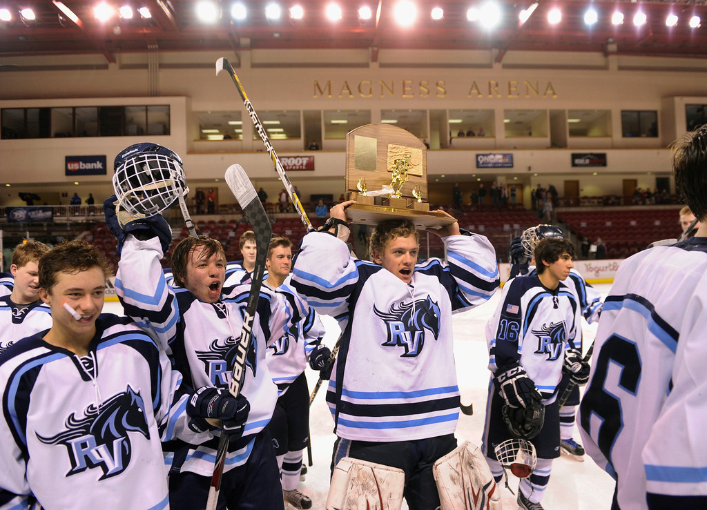 . DENVER, CO. - FEBRUARY 28: Mustangs goaltender Tyler Anderson carried the trophy off the ice Friday night. Ralston Valley High School beat Monarch 5-1 Friday night, March 1, 2013 to win the Colorado hockey championship at Magness Arena in Denver. (Photo By Karl Gehring/The Denver Post)