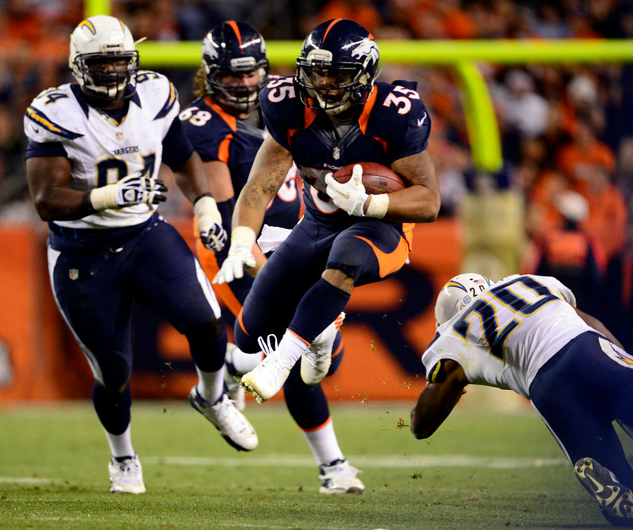 . Former Broncos running back Lance Ball dodges Chargers defenders. (AAron Ontiveroz, The Denver Post)