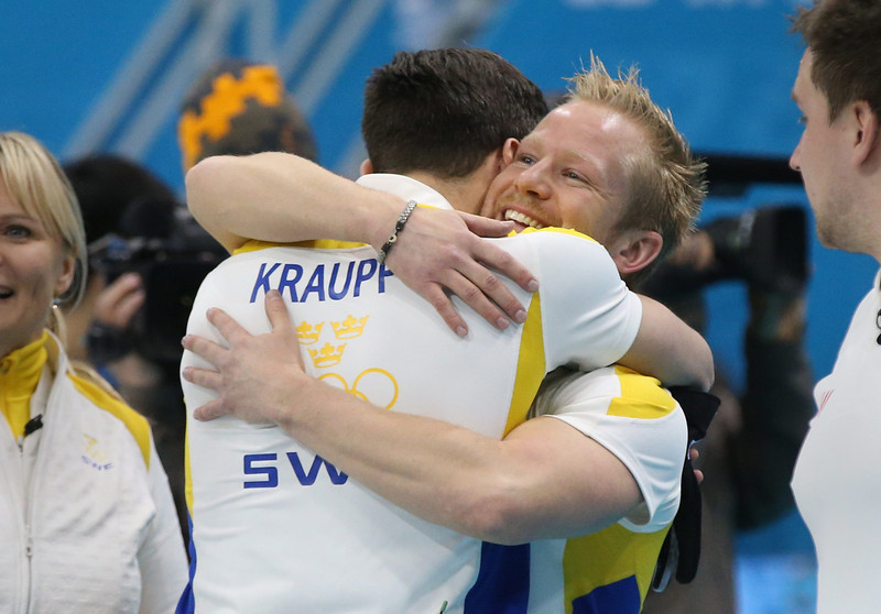 . Sebastian Kraupp (L) and Niklas Edin (R) of Sweden celebrate victory in the Bronze medal match between Sweden and China in the Men\'s Curling competition in the Ice Cube Curling Center at the Sochi 2014 Olympic Games, Sochi, Russia, 21 February 2014.  EPA/TATYANA ZENKOVICH