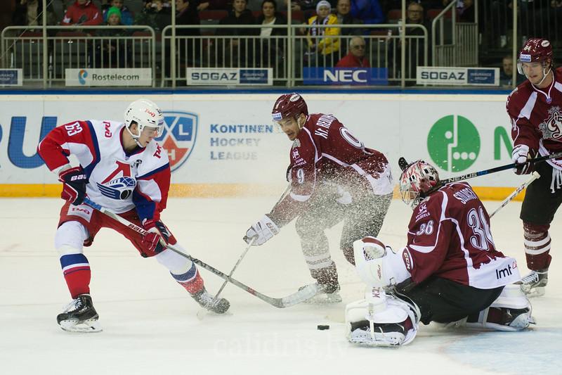 Pavel Kraskovsky (63) tries to score the goal