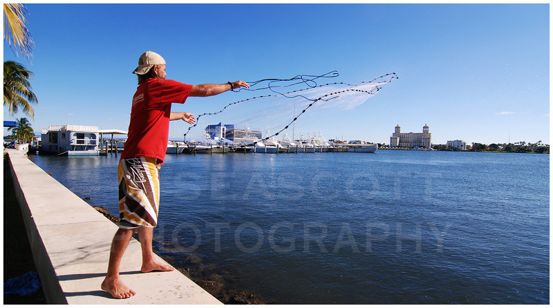 A homeless man casts his net toward Palm Beach, Florida, one of America's wealthiest communities.