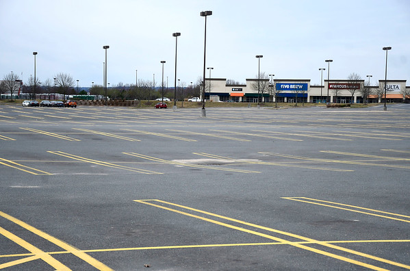 3/28/2020 Mike Orazzi | Staff The empty Connecticut Commons parking lot in Plainville on Saturday.
