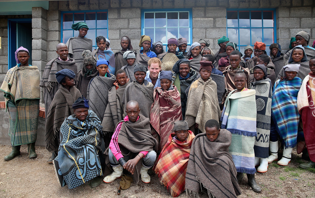 . Prince Harry poses for a photograph with herd boys during a visit to a herd boy night school constructed by Sentebale on December 8, 2014 in Mokhotlong, Lesotho. Prince Harry was visiting Lesotho to see the work of his charity Sentebale. (Photo by Chris Jackson/Getty Images for Sentebale)