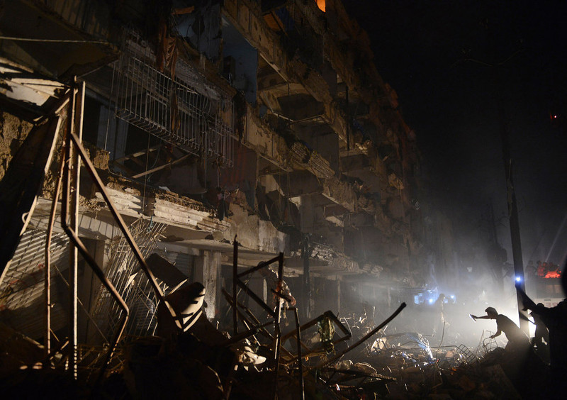 . A Pakistani rescuer works at the site of the bomb blast in Karachi on March 3, 2013.  A bomb attack in Pakistan\'s largest city Karachi on Sunday killed at least 23 people, including women and children, and wounded 50 others, police said.  ASIF HASSAN/AFP/Getty Images