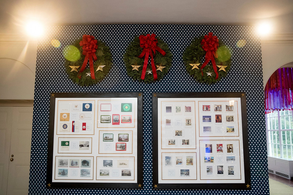 . Christmas cards from past presidents are displayed in the Booksellers area of the White House during a preview of the 2016 holiday decor, Tuesday, Nov. 29, 2016, in Washington. (AP Photo/Andrew Harnik)