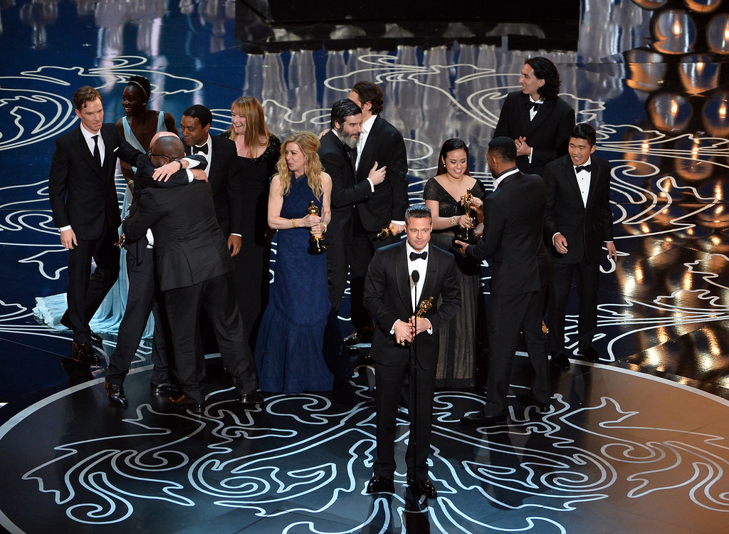 . Actor/producer Brad Pitt (C) accepts the Best Picture award for \'12 Years a Slave\' with (back row) actors Benedict Cumberbatch, Lupita Nyong\'o, Chiwetel Ejiofor, producers Dede Gardner, Jeremy Kleiner and Anthony Katagas onstage during the Oscars at the Dolby Theatre on March 2, 2014 in Hollywood, California.  (Photo by Kevin Winter/Getty Images)