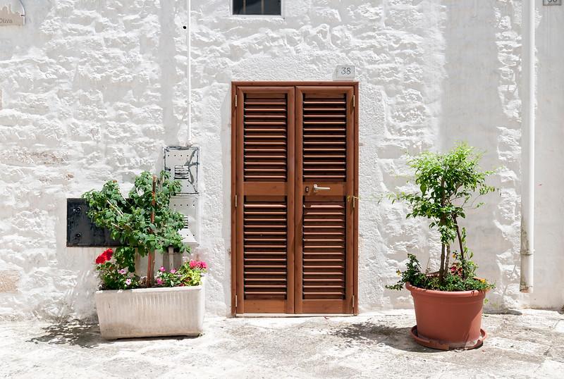 Shuttered Door and Flower-pot, Locorotondo, Apulia (Puglia), Italy