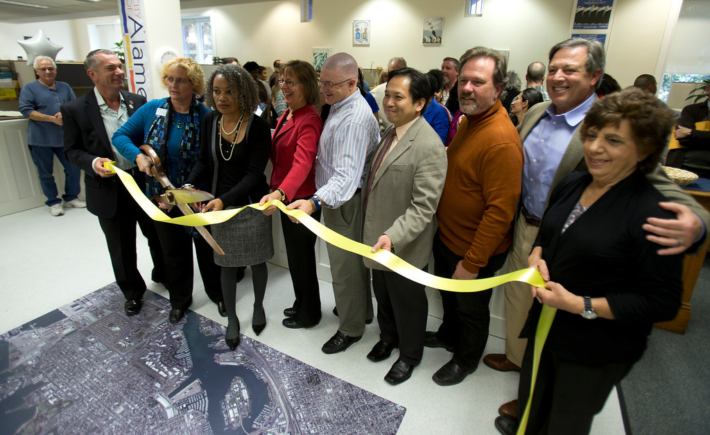 . Alameda, Calif. Mayor Marie Gilmore , third from left, leads the ribbon cutting at the newly remodeled Permit Center inside City Hall, Wednesday, Nov. 6, 2013 in Alameda. (D. Ross Cameron/Bay Area News Group)