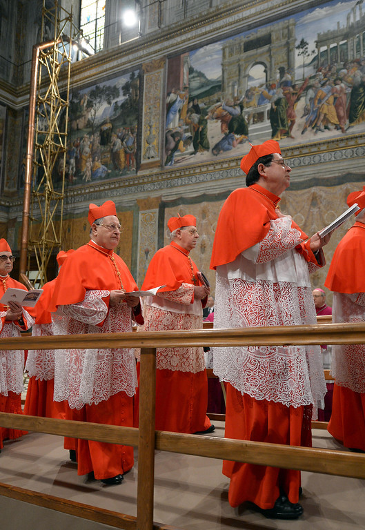 ". This handout picture released by the Press office shows cardinals arriving at the Sistine Chapel with the chimney in the background before the start of the conclave at the Vatican on March 12, 2013. �AFP PHOTO/OSSERVATORE ROMANO""-/AFP/Getty Images"