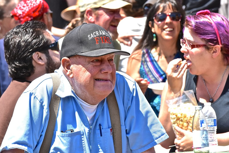 85- year-old Louie DeMartin wears a hat given him by his son, a fire chief in Sacramento, while listening to Moonstone Performance Outreach. José Quezada—For the Times-Standard