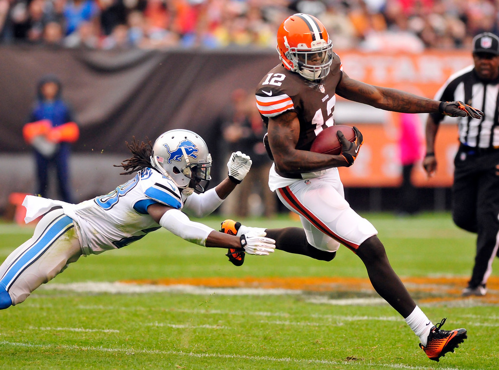 . Sam Greene/The Morning Journal Browns wide receiver Josh Gordon (12)  dodges a tackle attempt by Lions corner back Bill Bentley (28) on a reception during the second quarter of the NFL week six game between the Cleveland Browns and Detroit Lions at FirstEnergy Stadium in Cleveland, Ohio, on Sunday, Oct. 13, 2013. Gordon led the Browns receivers with 126 yards on 7 receptions.