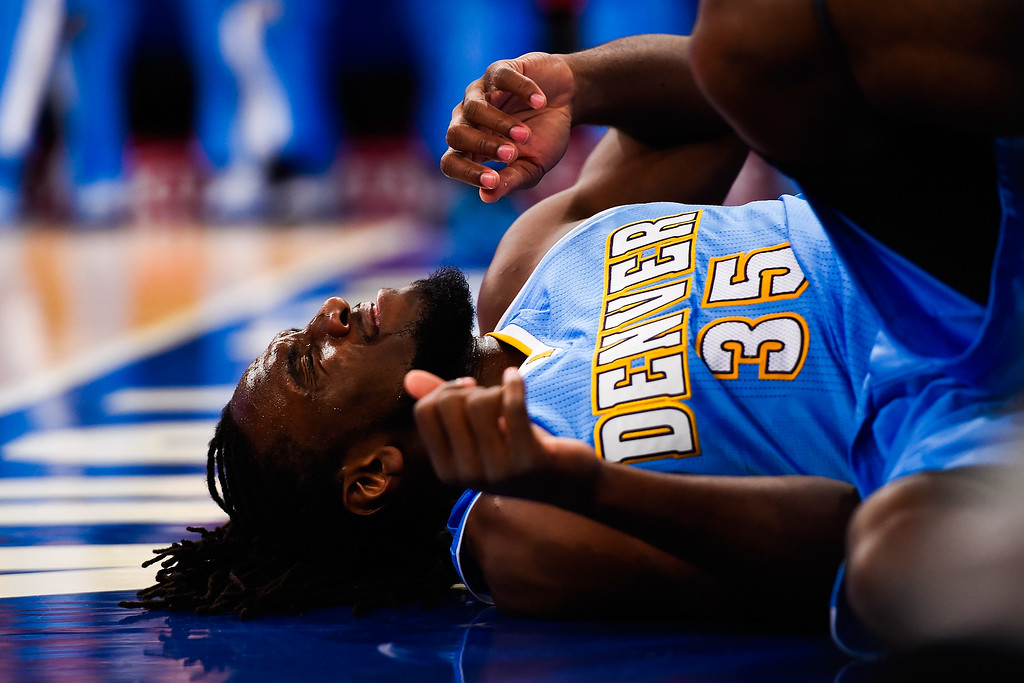 . NEW YORK, NY - NOVEMBER 16: Kenneth Faried #35 of the Denver Nuggets reacts after being fouled in the first half during a game against the New York Knicks at Madison Square Garden on November 16, 2014 in New York City. NOTE TO USER: User expressly acknowledges and agrees that, by downloading and/or using this photograph, user is consenting to the terms and conditions of the Getty Images License Agreement.  (Photo by Alex Goodlett/Getty Images)