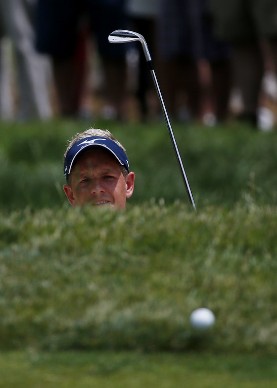 . Luke Donald of England hits a shot from a bunker on the second hole during Round Two of the 113th U.S. Open at Merion Golf Club on June 14, 2013 in Ardmore, Pennsylvania.  (Photo by Rob Carr/Getty Images)