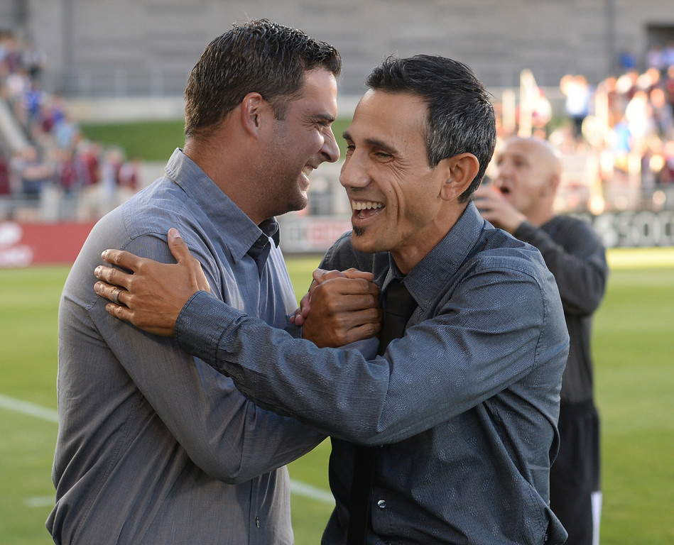 . COMMERCE CITY, CO - AUGUST 2: Salt Lake coach Jeff Cassar, left, exchanged pleasantries with Colorado coach Pablo Mastroeni, right, before the game. Real Salt Lake defeated the Colorado Rapids 1-0 at Dick\'s Sporting Goods Park Saturday night, August 2, 2014.  Photo by Karl Gehring/The Denver Post