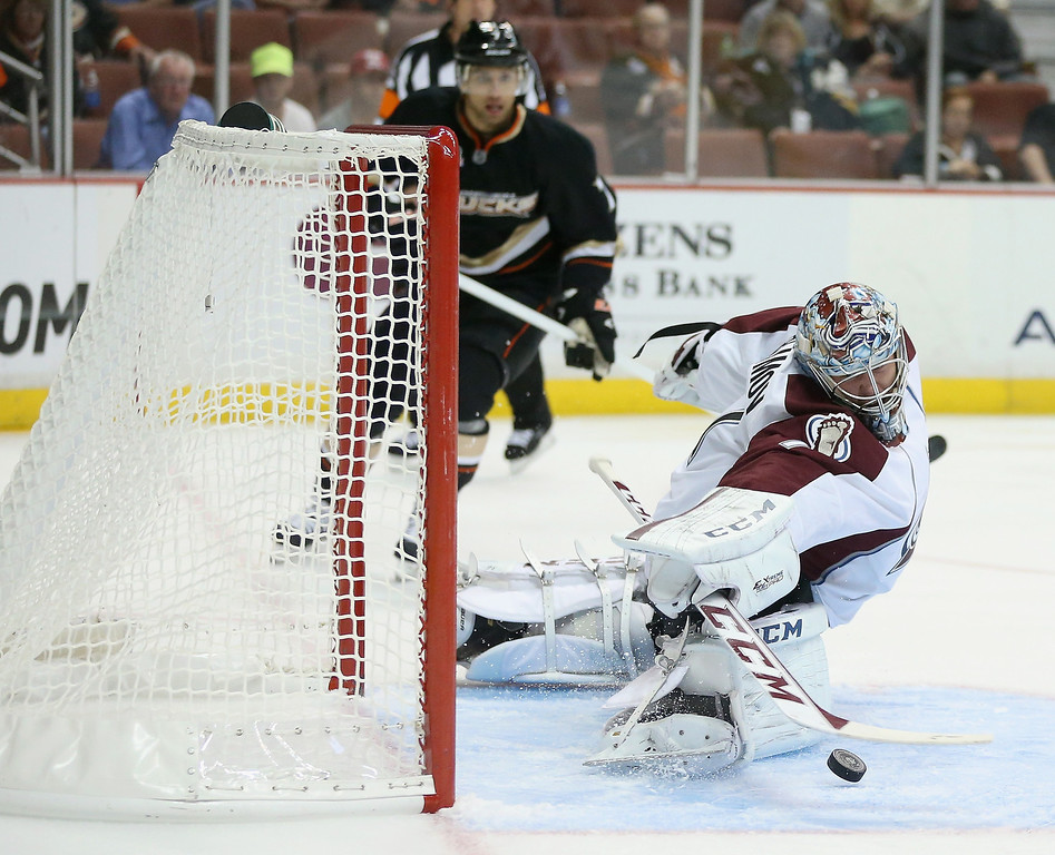 . Goaltender Semyon Varlamov #1 of the Colorado Avalanche makes a save against the Anaheim Ducks in the first period at Honda Center on September 22, 2013 in Anaheim, California.  (Photo by Jeff Gross/Getty Images)