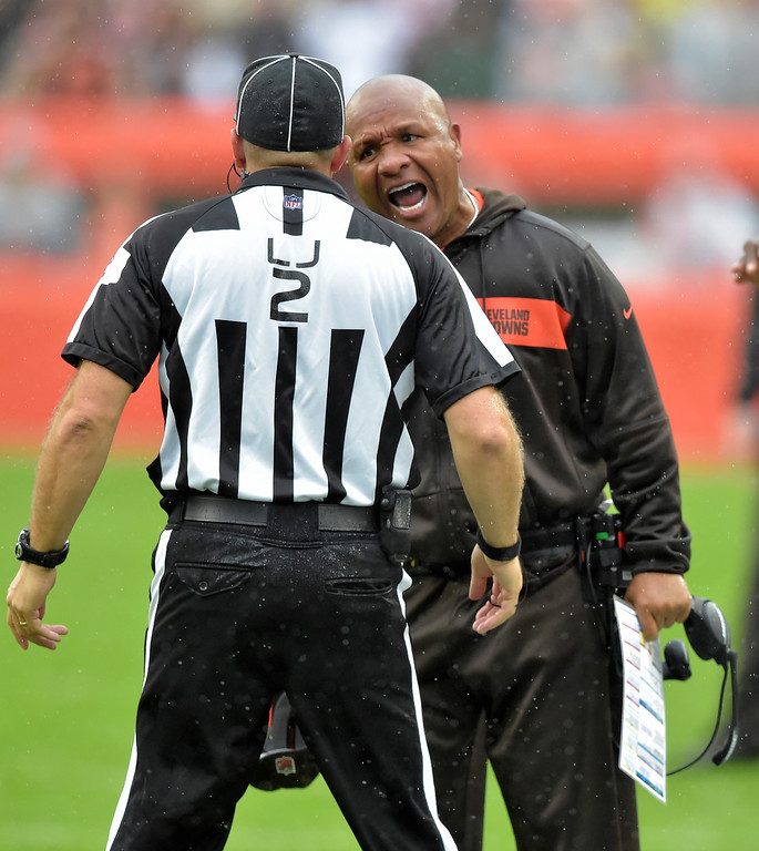 . Cleveland Browns head coach Hue Jackson, right, reacts to line judge Bart Longson during the first half of an NFL football game against the Pittsburgh Steelers, Sunday, Sept. 9, 2018, in Cleveland. (AP Photo/David Richard)
