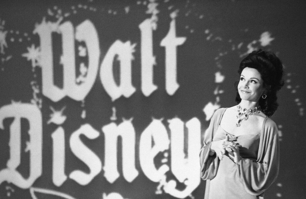 """. Actress Annette Funicello recalls moments when she played a \""""Mouseketeer\"""" on ABC\'s first successful daytime television show,\""""The Mickey Mouse Club\"""" in Los Angeles, Jan. 3, 1978. She was taping ABC\'s Silver Anniversary Celebration special to be aired on February 5. As Annette looks at the projected background screen, she leads the audience in singing the Mickey Mouse theme song. (AP Photo/Lennox McLendon)"""