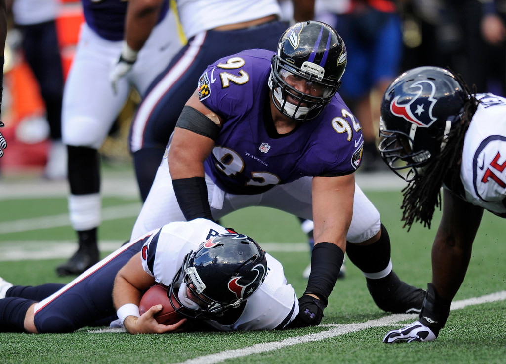 . Baltimore Ravens defensive tackle Haloti Ngata (92) lifts himself off of Houston Texans quarterback Matt Schaub after sacking him in the first half of an NFL football game Sunday, Sept. 22, 2013, in Baltimore. (AP Photo/Nick Wass)