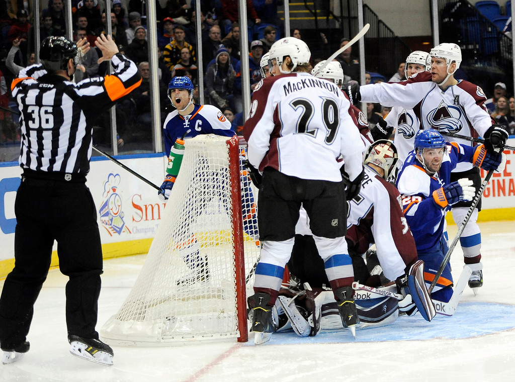 . New York Islanders\' John Tavares, second from left, reacts to a no goal call by a referee as the Colorado Avalanche stand by in the second period of an NHL hockey game on Saturday, Feb. 8, 2014, in Uniondale, N.Y. (AP Photo/Kathy Kmonicek)