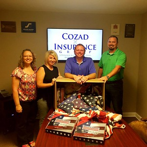 cozad-insurance-group-promotes-patriotism-by-exchanging-new-american-flags-for-worn-flags