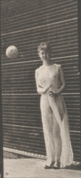 Semi-nude woman picking up a ball and throwing it