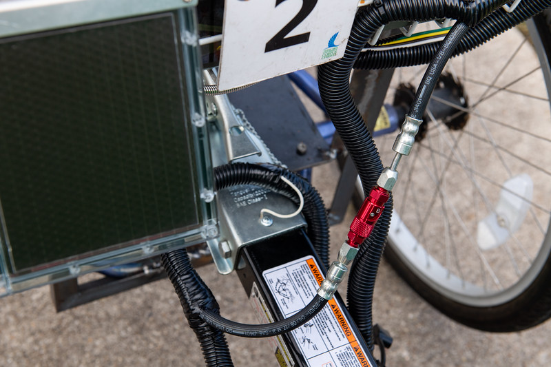 The solar panel on the left will power the new Islanders Green Garden bike's blinkers. The Hydraulic Quick Connect on the right will assist with bringing the bike and trailer to a safe stop.