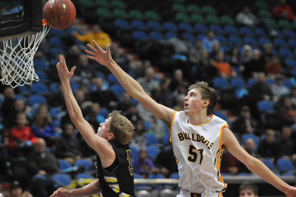 . Cretin-Derham Hall\'s Joe Rosga drives to the basket against Bettendorf\'s (Iowa) Nicholas Baer in the second half of their matchup as Bettendorf won 71-66. (Pioneer Press: Scott Takushi)