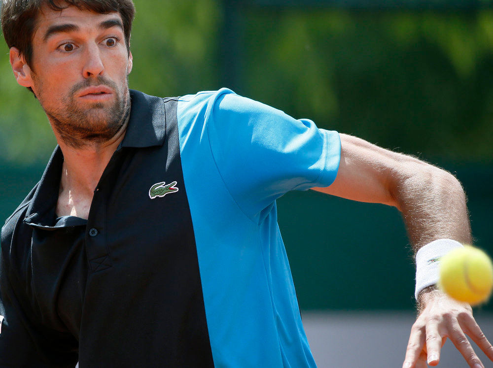 . France\'s Jeremy Chardy eyes the ball during his French Tennis Open match against Spain\'s Roberto Bautista Agut during at the Roland Garros stadium in Paris, on May 29,  2013.  KENZO TRIBOUILLARD/AFP/Getty Images