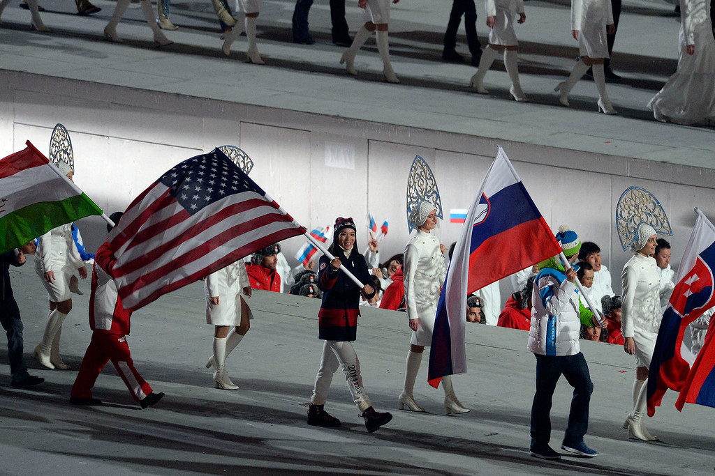 . American flag bearer hockey player Julie Chu walks with other bearers during closing ceremony for the Sochi 2014 Winter Olympics. Sochi 2014 Winter Olympics on Sunday, February 23, 2014 at Fisht Olympic Stadium. (Photo by AAron Ontiveroz/ The Denver Post)