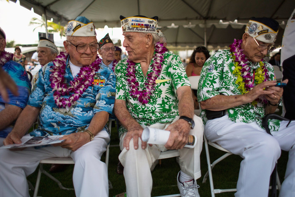 . Pearl Harbor survivors Michael Ganitch of California and Robert McCoy of Hawaii talk during the 71st Annual Memorial Ceremony commemorating the WWII Attack On Pearl Harbor at the World War 2 Valor in the Pacific National Monument December 7, 2012 in Pearl Harbor, Hawaii. This is the 71st anniversary of the Japanese attack on pearl Harbor.  (Photo by Kent Nishimura/Getty Images)