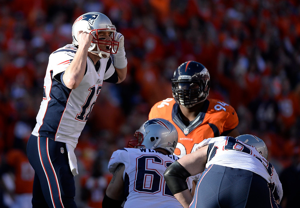 . New England Patriots quarterback Tom Brady (12) yells a play at the line in the third quarter. The Denver Broncos take on the New England Patriots in the AFC Championship game at Sports Authority Field at Mile High in Denver on January 19, 2014. (Photo by AAron Ontiveroz/The Denver Post)