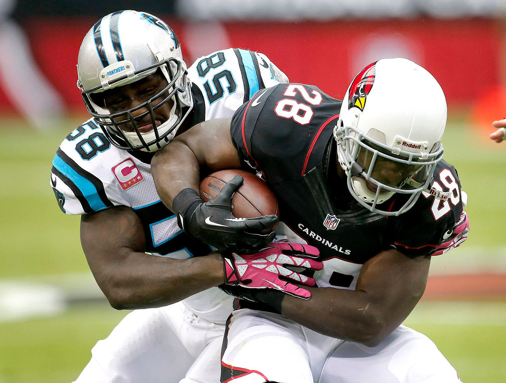 . Arizona Cardinals running back Rashard Mendenhall (28) is tackled by Carolina Panthers outside linebacker Thomas Davis (58)during the first half of a NFL football game, Sunday, Oct. 6, 2013, in Glendale, Ariz. (AP Photo/Matt York)