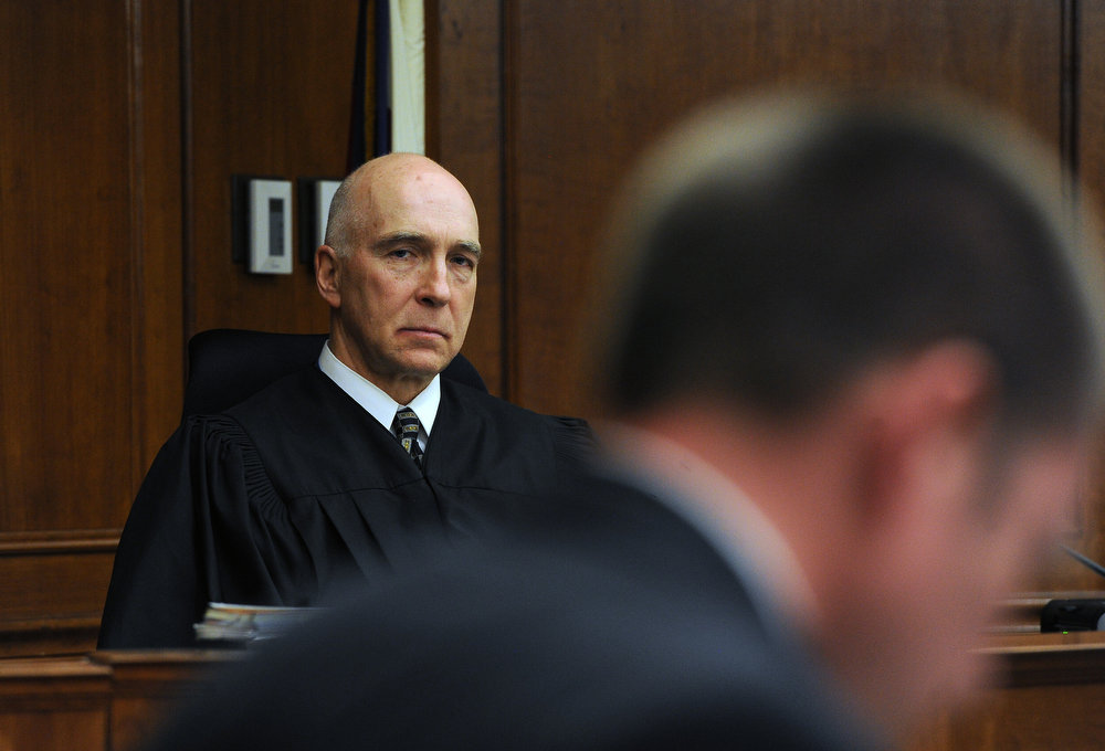 . Judge William Sylvester listens to the proceedings.  A hearing was held today to set a date for the execution of convicted murderer Nathan Dunlap at the Arapahoe County Court in Division court room 408  in Centennial, CO on May 1, 2013.   Judge William Sylvester is the presiding judge on the case.  (Photo by Helen H. Richardson/The Denver Post)