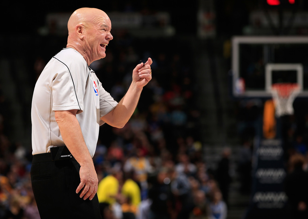 . DENVER, CO - NOVEMBER 03:  Referee Joey Crawford shares a lighter moment as he oversees the action between the Sacramento Kings and the Denver Nuggets at Pepsi Center on November 3, 2014 in Denver, Colorado. The Kings defeated the Nuggets 110-105. NOTE TO USER: User expressly acknowledges and agrees that, by downloading and or using this photograph, User is consenting to the terms and conditions of the Getty Images License Agreement.  (Photo by Doug Pensinger/Getty Images)