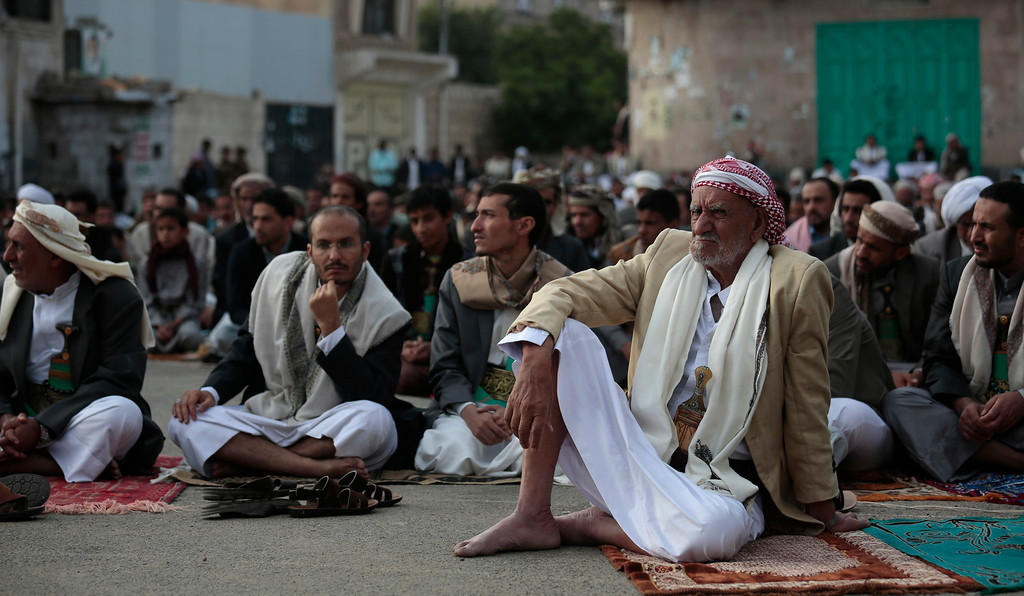 . Yemeni Muslims offer prayers to celebrate Edi al-Adha, or Feast of Sacrifice, that commemorates the Prophet Ibrahim\'s faith, in Sanaa, Yemen, Monday, Sept. 12, 2016. Muslims around the world are celebrating the first day of Eid al-Adha, or �Feast of Sacrifice,� the most important Islamic holiday that commemorates the willingness of the Prophet Ibrahim _ also known as Abraham to Christians and Jews _ to sacrifice his son.  (AP Photo/Hani Mohammed)
