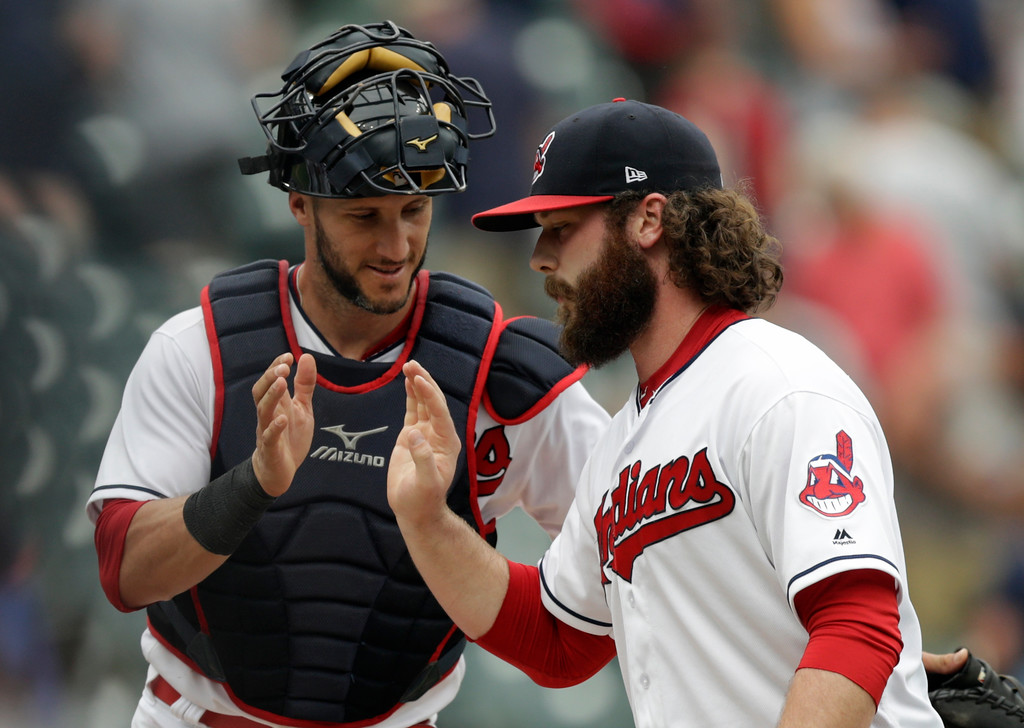 . Cleveland Indians catcher Yan Gomes, left congratulates Cleveland Indians relief pitcher Ben Taylor after the Indians defeated the Chicago White Sox 9-1 in a baseball game, Wednesday, May 30, 2018, in Cleveland. (AP Photo/Tony Dejak)