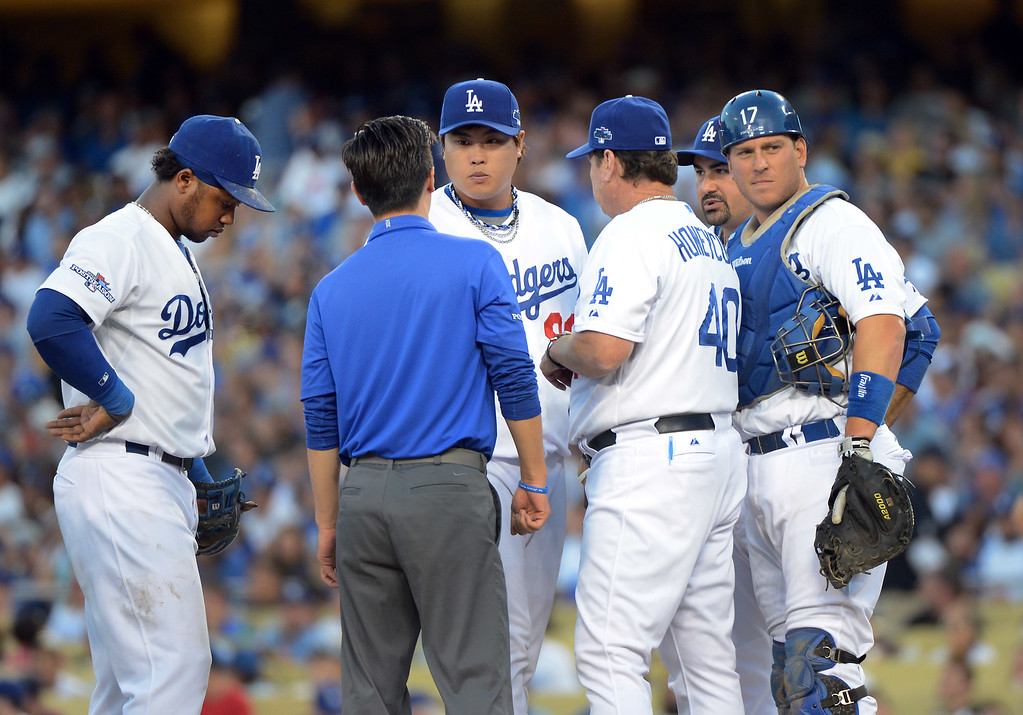 . Los Angeles Dodgers players and coaches meet at the mound with Hyun-Jin Ryu during game 3 of the NLDS at Dodger Stadium Sunday, October 6, 2013. (Photo by David Crane/Los Angeles Daily News)