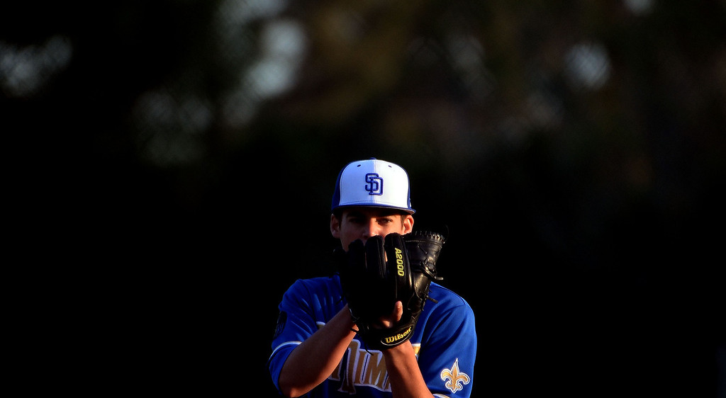 . San Dimas starting pitcher Peter Lambert (C) eyes the plate against Bonita in the first inning of a prep baseball game at Bonita High School in La Verne, Calif., on Wednesday, March 19, 2014.  (Keith Birmingham Pasadena Star-News)