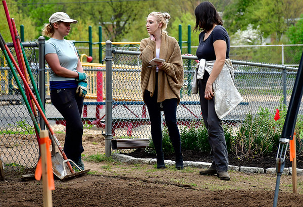 5/9/2019 Mike Orazzi | Staff Kayla Murphy talks with Laura Hart and Aimee Petras about a rain garden being installed in Bristol's Page Park on Thursday morning.