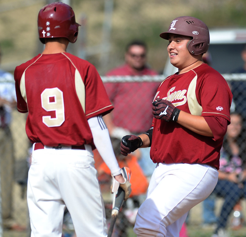 . La Serna\'s John Mendoza (#38) is congratulated after hitting a three-run homerun as they play Sata Fe in their Del Rio League game at La Serna High School in Whittier on Wednesday April 23, 2014. (Staff Photo by Keith Durflinger/Whittier Daily News)
