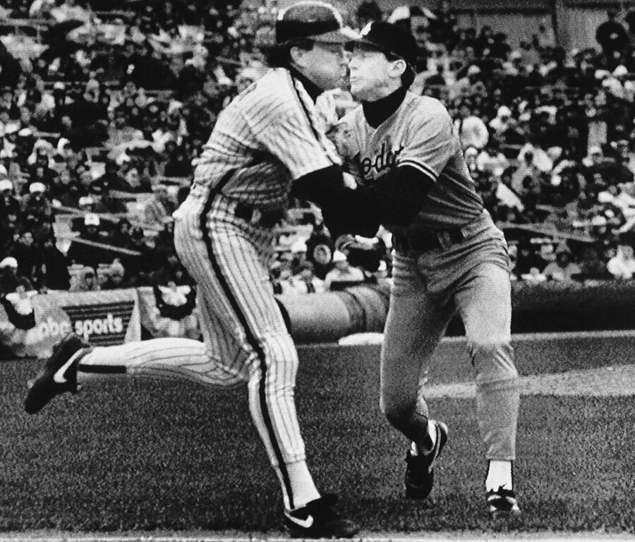 . Los Angeles Dodgers pitcher Orel Hershiser, right, tags New York Mets batter Gary Carter out along the first base line after fielding Carters bunt attempt in the second inning of NL playoff game, Saturday, Oct. 8, 1988, New York. (AP Photo/Ray Stubblebine)