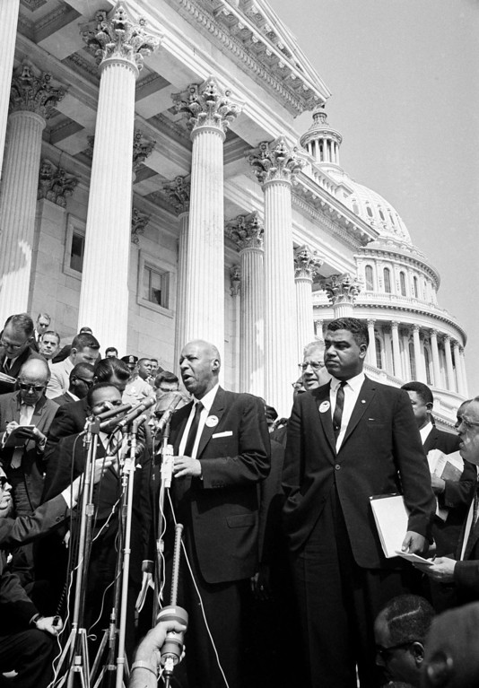 . A. Philip Randolph, head of the  Brotherhood of Sleeping Car Porters, talks to newsmen at the Capitol after leader of the March on Washington met with congressional leaders, Aug. 28, 1963. At right is Whitney Young of the National Urban League. (AP Photo)