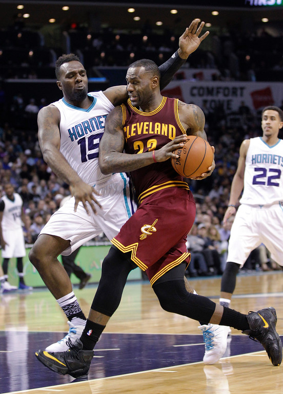 . Cleveland Cavaliers forward LeBron James, right, drives into Charlotte Hornets forward P.J. Hairston during the second half of an NBA basketball game Wednesday, Feb. 3, 2016 in Charlotte, N.C. Charlotte won 106-97. (AP Photo/Nell Redmond)