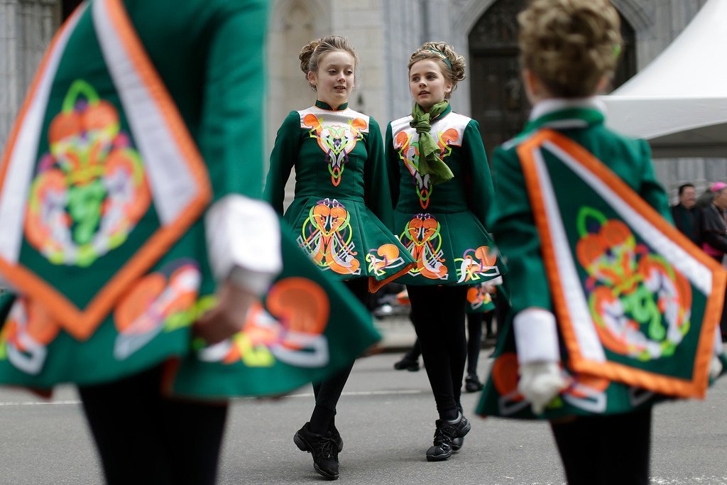 . Participants perform a traditional Irish dance as they march up Fifth Avenue during the St. Patrick\'s Day Parade, Tuesday, March 17, 2015, in New York.  (AP Photo/Mary Altaffer)