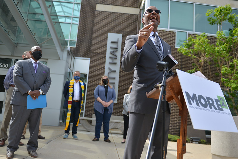 Rev. Bobby Love., co-chair of Metro Organization for Racian and Economic Equity, and other clergy call for the resignation of Overland Park Police Chief Frank Donchez on Monday.