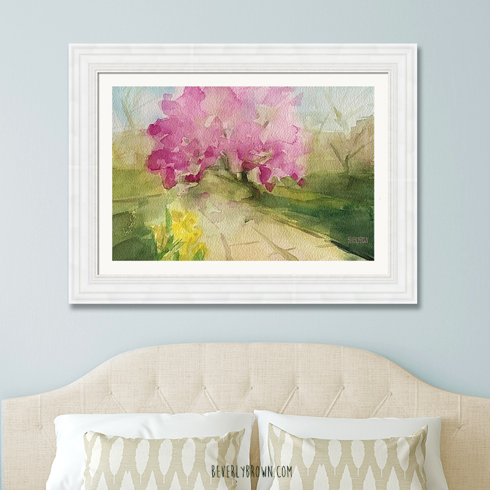 Light blue bedroom with framed magnolia tree Central Park print over the bed by Beverly Brown.