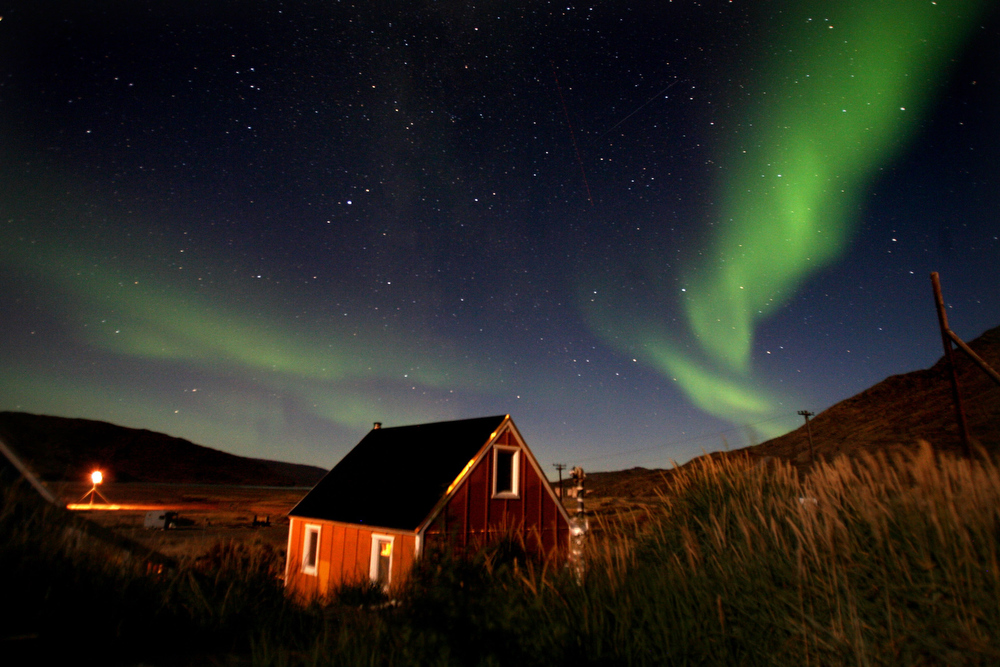 Description of . The Aurora Borealis glows in the sky, September 03, 2007, in the Greenland town of Kangerlussuaq. The Northern Lights most often occurs from September to October and from March to April and are a popular tourist attraction.  (Photo by Uriel Sinai/Getty Images)