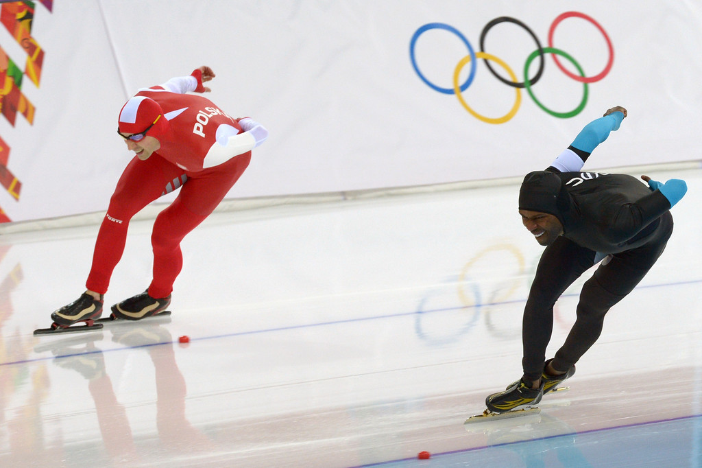 . Poland\'s Zbigniew Brodka competes next to US Shani Davis (R) in the Men\'s Speed Skating 1500 m at the Adler Arena during the Sochi Winter Olympics on February 15, 2014.     DAMIEN MEYER/AFP/Getty Images