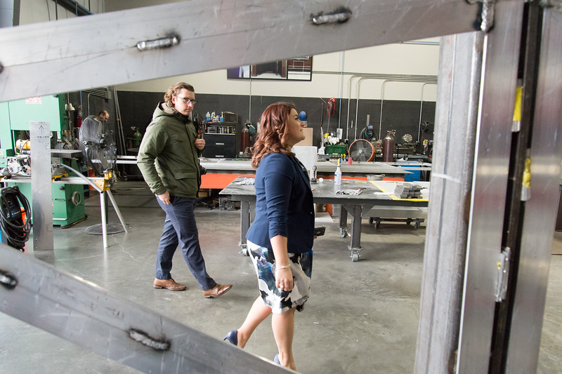 02/15/19  Wesley Bunnell | Staff  Mayor Erin Stewart is shown through a triangle cutout which will be fitted with a colored plexiglass trim piece for the upcoming Beehive Bridge project during a tour of Sign Pro in Southington on Friday afternoon.